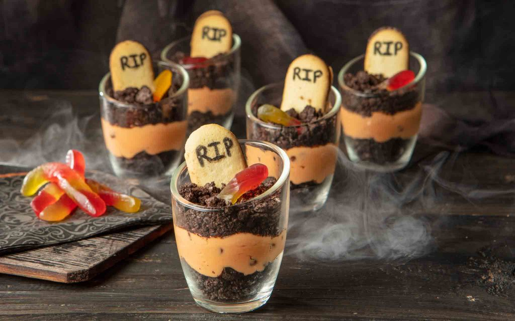orange and black halloween graveyard dirt cake cheesecake trifles