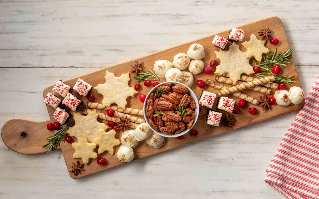 cranberries and star anise on a holiday dessert charcuterie board