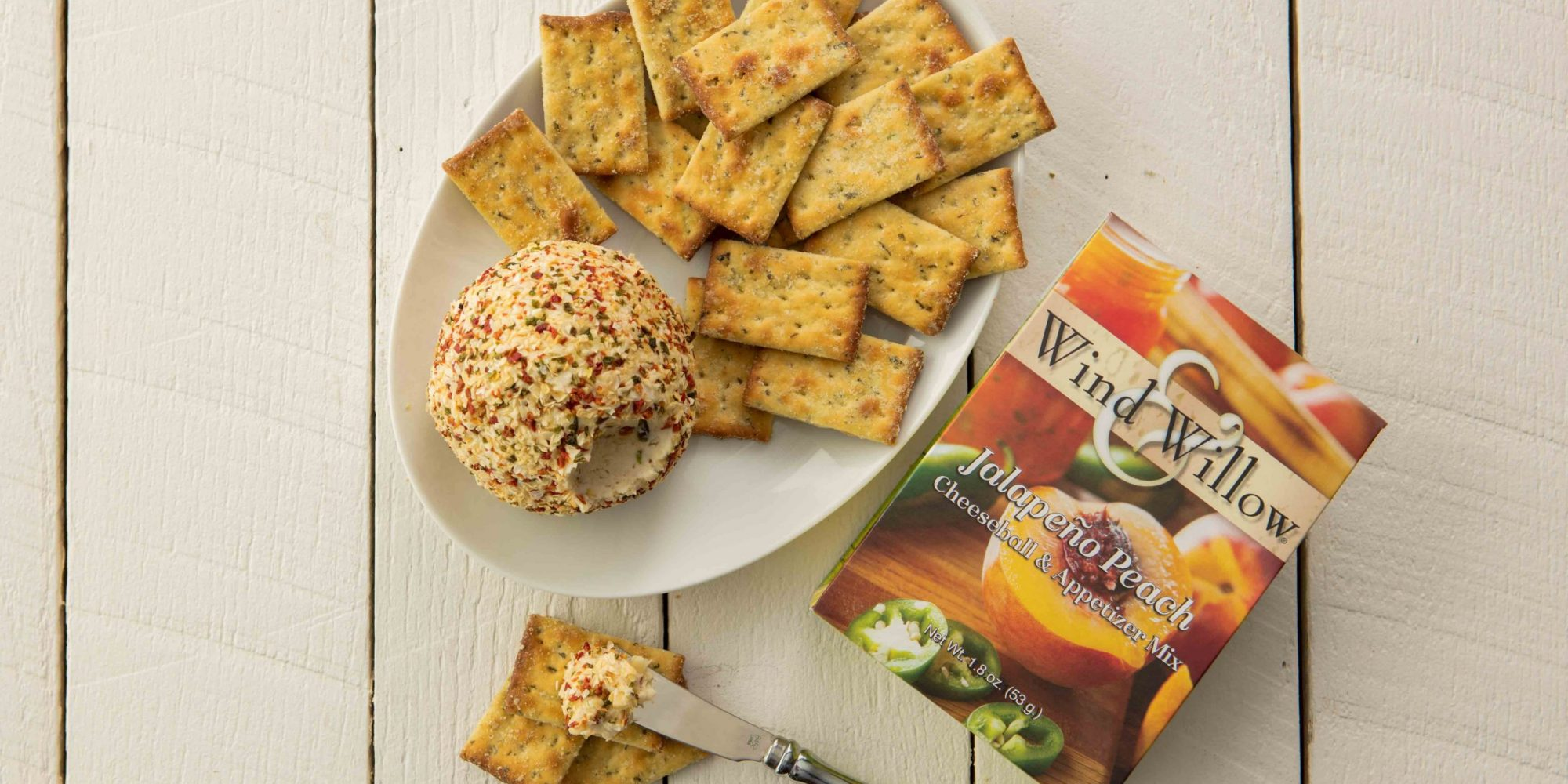 Jalapeno peach cheeseball and crackers, sweet and savory, sweet heat